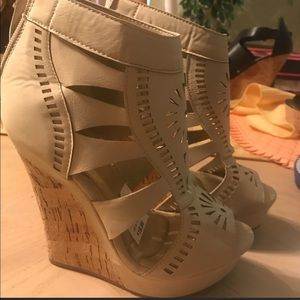 High wedge suede front tie w zipper on back.
